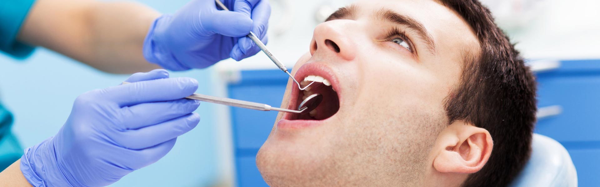 Dentist examining patient for dental surgery