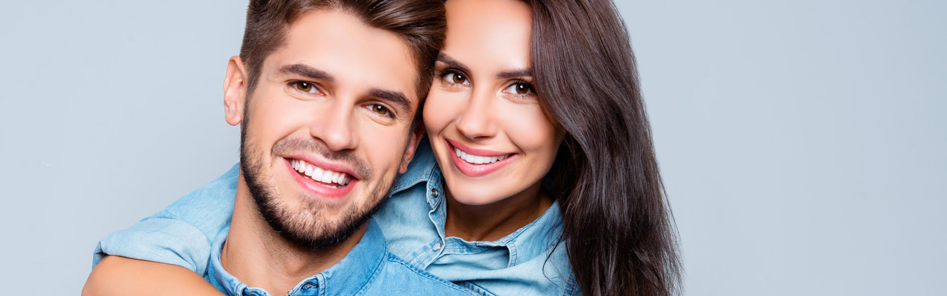Happy couple after having cosmetic dentistry treatment