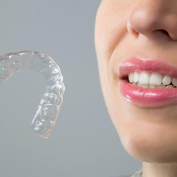 Woman holding an invisalign braces