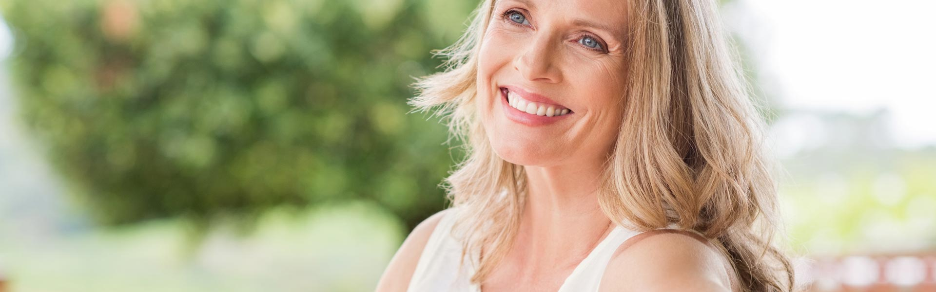 Happy woman after having endodontics treatment